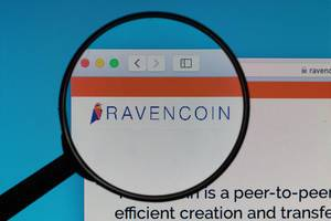 Ravencoin logo under magnifying glass