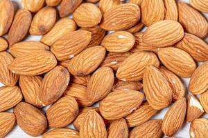 Raw almond nuts background. Top view (Flip 2019)