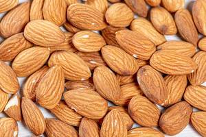 Raw almond nuts background. Top view