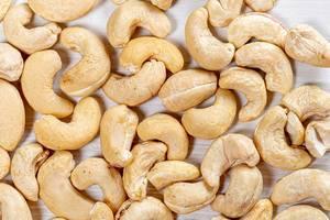 Raw cashews nut background. Top view (Flip 2019)