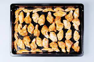 Raw chicken wings in pan, ready to be cooked (Flip 2019)