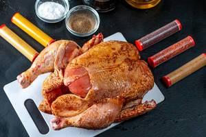 Raw chicken with natural spices on dark background (Flip 2019)