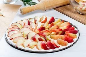Raw-open-peach-pie-on-a-baking-sheet.jpg
