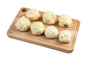Raw Plum Dumplings on the wooden board