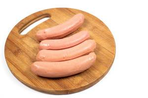 Raw Sausages on the round wooden board (Flip 2020)