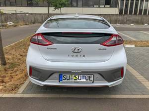 Rear view of mid-size electric car Hyundai Ioniq in a parking spot