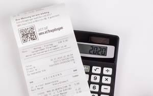 Receipt on black calculator