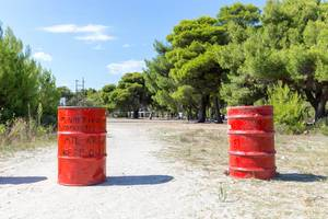 Red barrels at the entrance to a military area