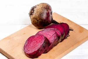 Red beet roots on kitchen board
