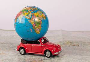 Red beetle car with globe on map (Flip 2019)