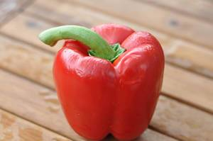 Red bell pepper on wooden table