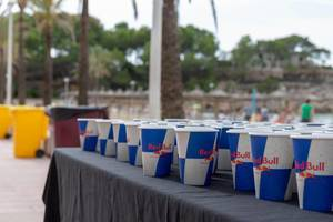 Red Bull paper cups with refreshment for the athlets