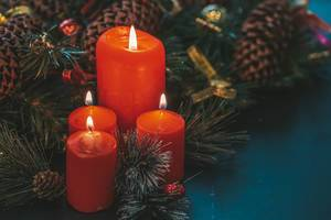 Red candles on dark background with Christmas tree branches (Flip 2019)