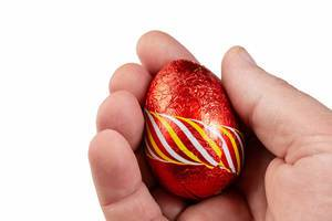 Red Chocolate Easter Egg in the hand (Flip 2019)