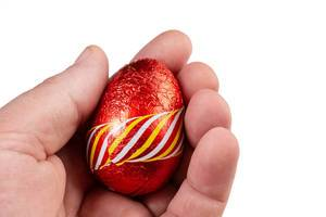 Red Chocolate Easter Egg in the hand