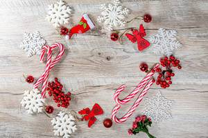 Red Christmas decor and white snowflakes on wooden background with free space (Flip 2019)