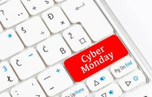 Red Cyber Monday button on white keyboard