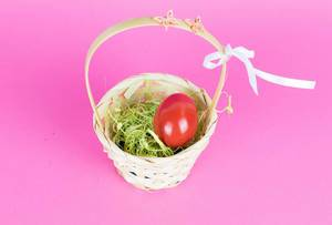 Red Easter egg in a basket