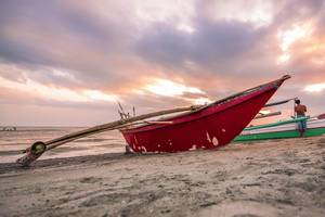 Red Fishing Boat docked in Villa Azul