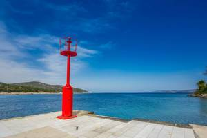 Red lighthouse on island Cres, Croatia
