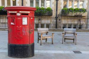 Red Royal Mailbox on a street of London
