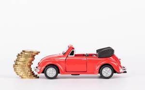 Red toy car with stack of coins