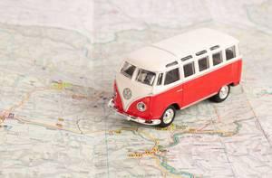 Red vintage camper van on map