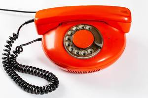 Red vintage phone on white background
