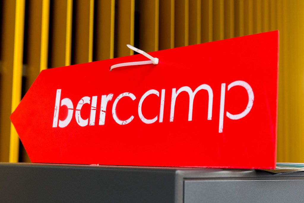 Red-white arrow and entrance sign for German Barcamp in Wiesbaden