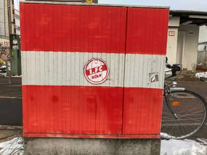 Red-white painted wall with sticker oft he football club 1. FC Köln with bicycle in the background