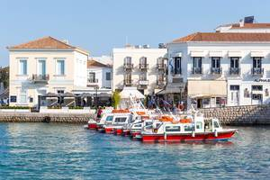 Red-white water taxis in the Greek port in the Myrtoan Sea