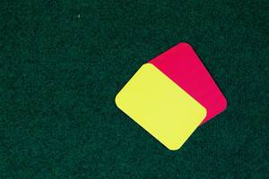 Referee cards on grass background