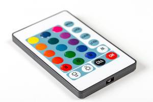 Remote control with multi-colored buttons on a white background (Flip 2019)