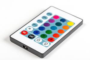 Remote control with multi-colored buttons on a white background