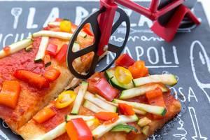 Rennrad-Pizzamesser