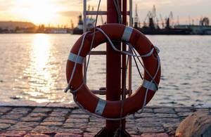 Rescue: Lifebelt at sea port. Sunset view