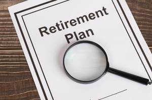 Retirement Plan with magnifying glass