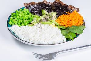 Rice with fresh vegetables, spinach, Chia seeds and nori on a white background