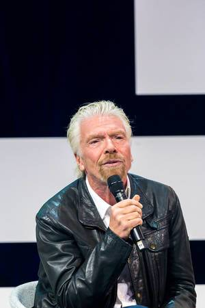 Richard Branson on stage of Digital X