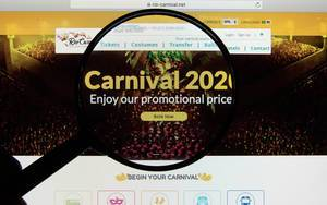 Rio Carnival 2020 website on a computer screen with a magnifying glass