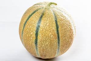 Ripe round melon on white wooden table (Flip 2019)
