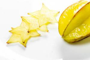 Ripe star fruit with slices on white background - carambola (Flip 2019)