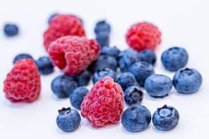 Ripe summer berries of blueberries and raspberries (Flip 2019)