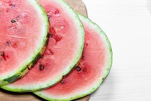 Ripe watermelon sliced in circles closeup