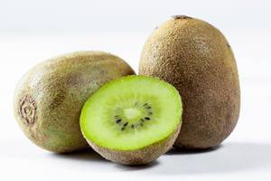 Ripe whole kiwi fruit and half kiwi fruit on white background