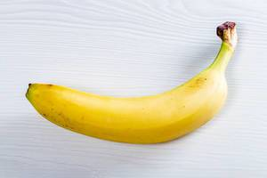 Ripe yellow banana on white background (Flip 2019)