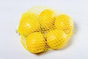 Ripe yellow lemons Packed in mesh (Flip 2019)