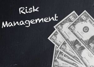 Risk Management text with US dollar banknotes