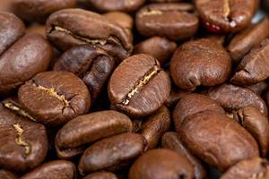 Roasted coffee beans background, closeup