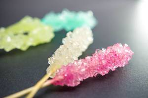 Rock candy on a black surface